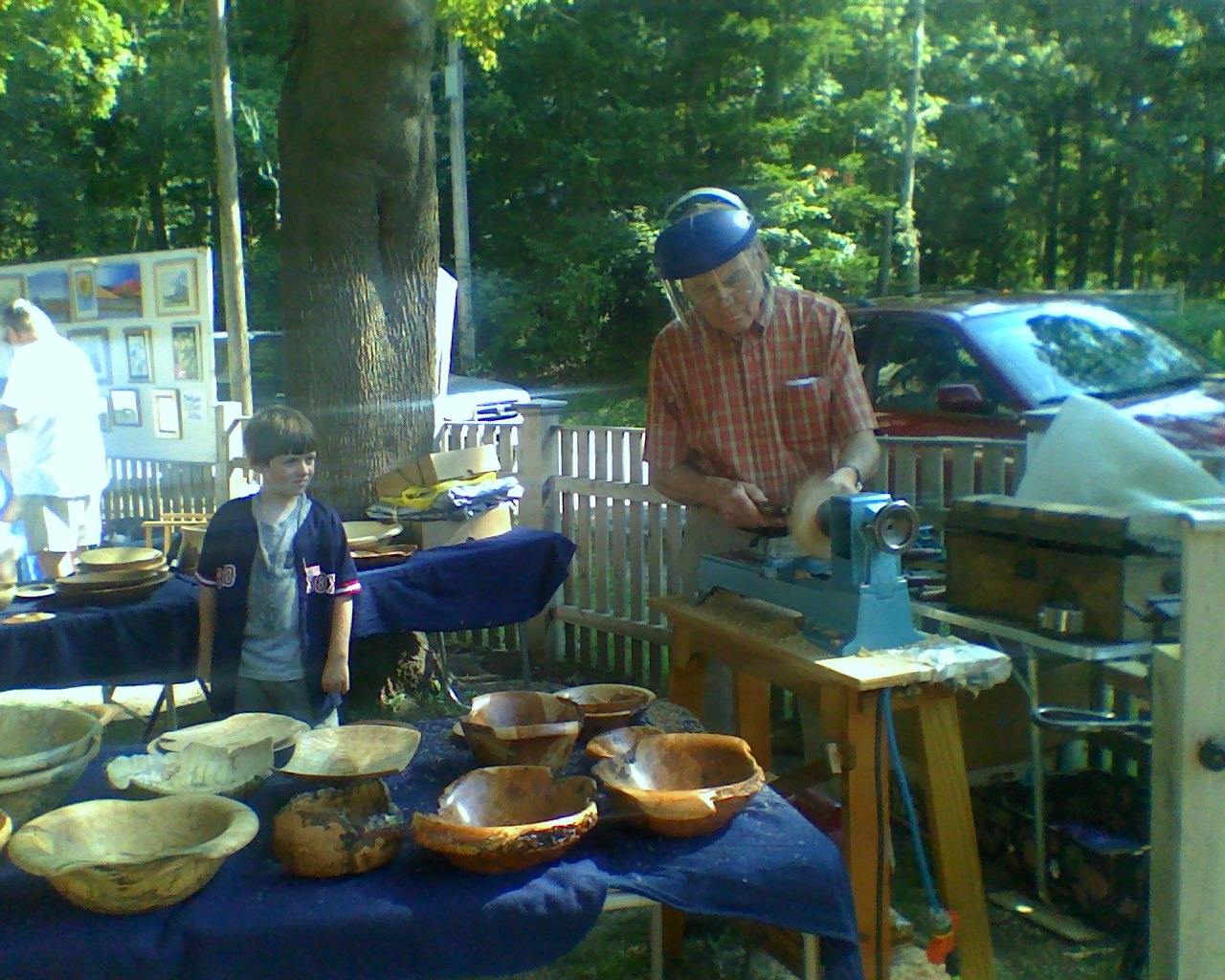Jeff Tubman at CAF turning wood bowls with Isaac York.jpg